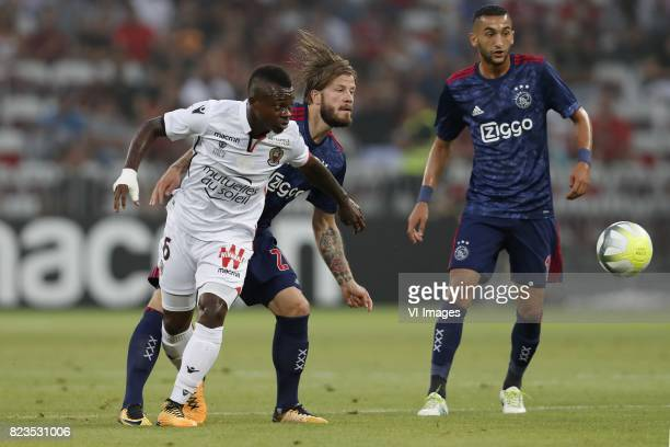 Mario Balotelli of OCG Nice Lasse Schone of Ajax Hakim Ziyech of Ajax during the UEFA Champions League third round qualifying first leg match between...