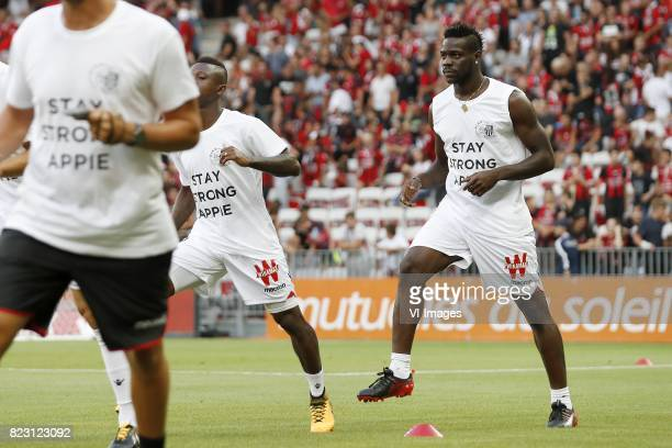 Mario Balotelli of OCG Nice with shirt Abdelhak Nouri of Ajax stay strong during the UEFA Champions League third round qualifying first leg match...