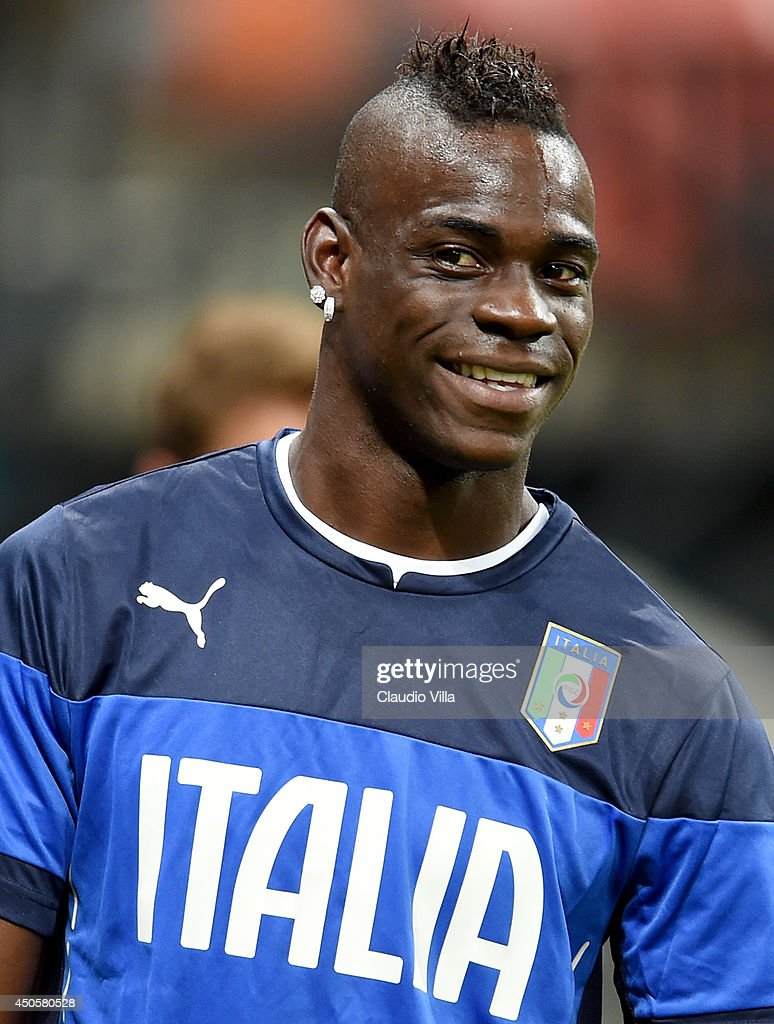Mario Balotelli smiles during an Italy training session at the Arena Amazonia on June 13 2014 in Manaus Brazil Italy will play England in their...