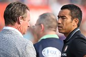 Mario Been coach Giovanni van Bronckhorst of Feyenoord during the preseason friendly match between Feyenoord and Valencia on July 23 2016 at the Kuip...