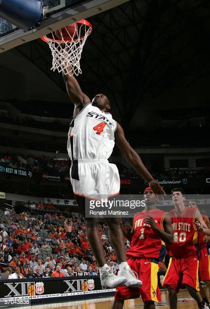 Mario Boggan of the Oklahoma State Cowboys goes up for a slam dunk against the Iowa State Cyclones during the first round of the Phillips 66 Big 12...