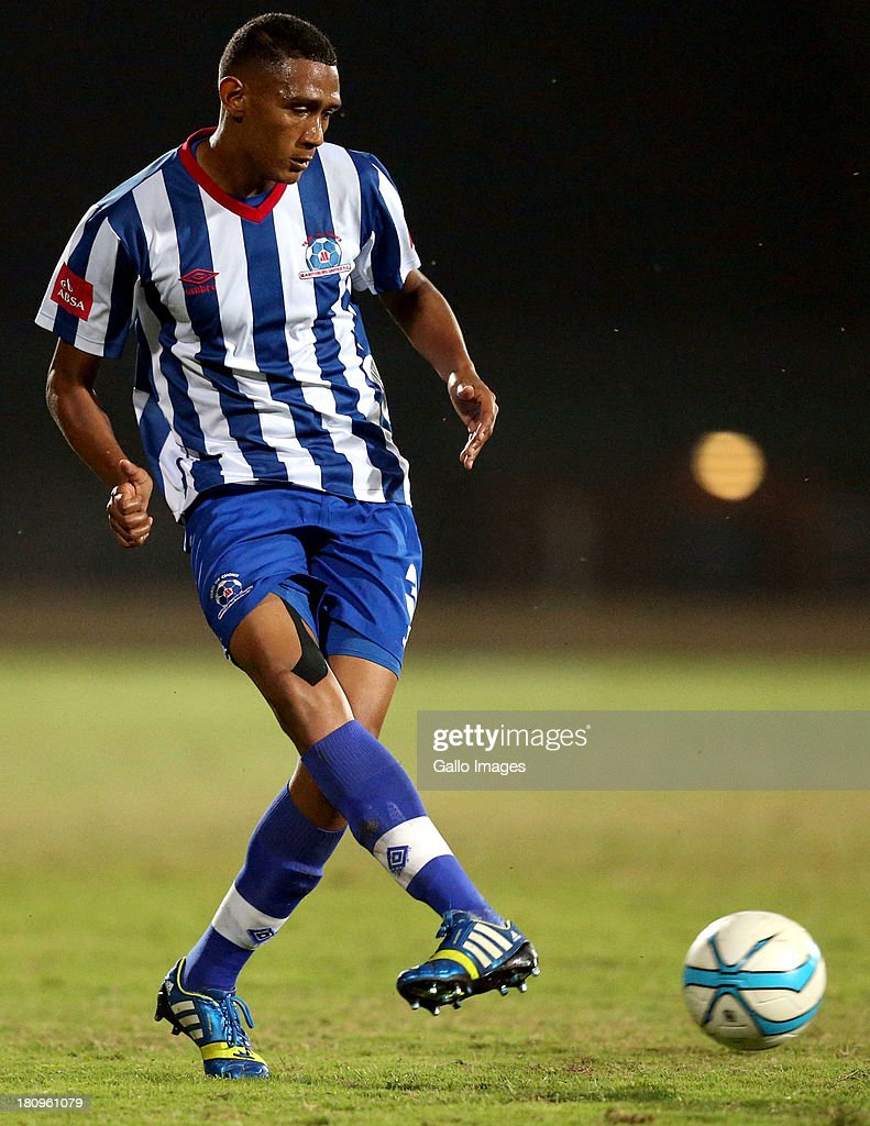Mario Booysen of Maritzburg Utd in action during the Absa Premiership match between Maritzburg United and MP Black Aces at Harry Gwala Stadium on September 18, 2013 in Durban, South Africa.