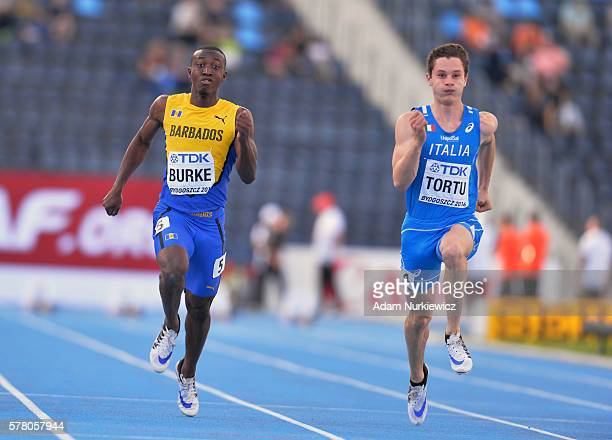 Mario Burke from Barbados and Filippo Tortu from Italy compete in men's 100 metres semifinal during the IAAF World U20 Championships at the Zawisza...