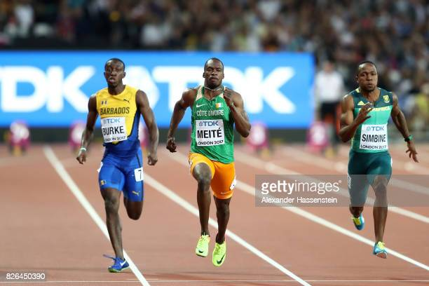Mario Burke of Barbados and Ben Youssef Meite of Cote d'Ivoire competes in the Men's 100 metres heats during day one of the 16th IAAF World Athletics...