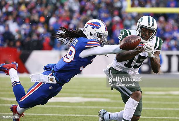 Mario Butler of the Buffalo Bills breaks up a reception intended for Brandon Marshall of the New York Jets during the second half at Ralph Wilson...