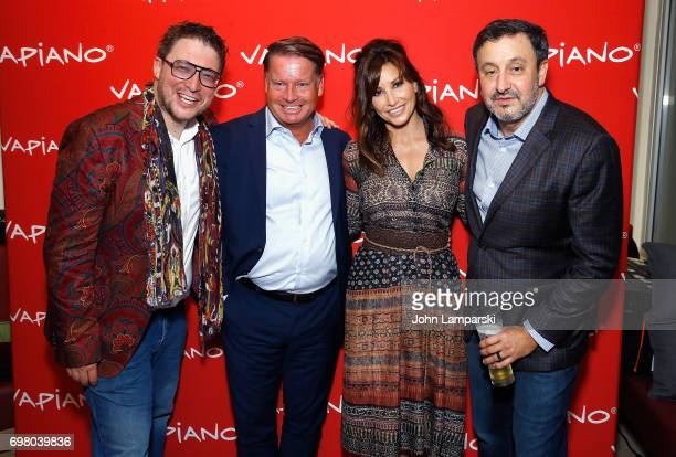Mario C Bauer CEO Jochen Halfmann Gina Gershon and CEO USA Carlos Politano attend Vapiano Grand ReLaunch Party at Vapiano on June 19 2017 in New York...