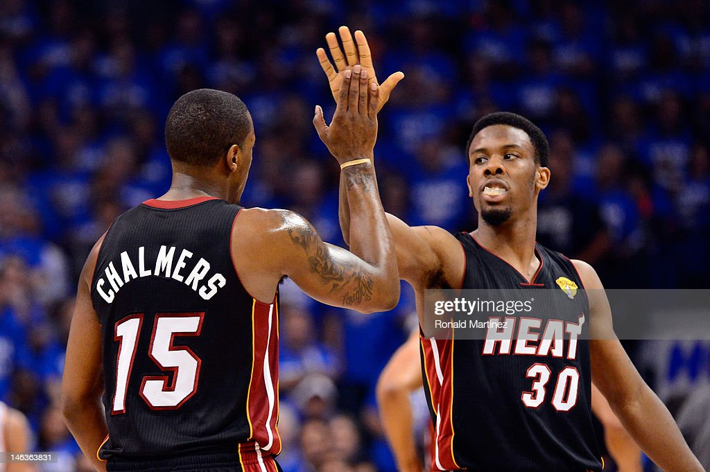 Mario Chalmers and Norris Cole of the Miami Heat celebrate a play in the first half while taking on the Oklahoma City Thunder in Game Two of the 2012...