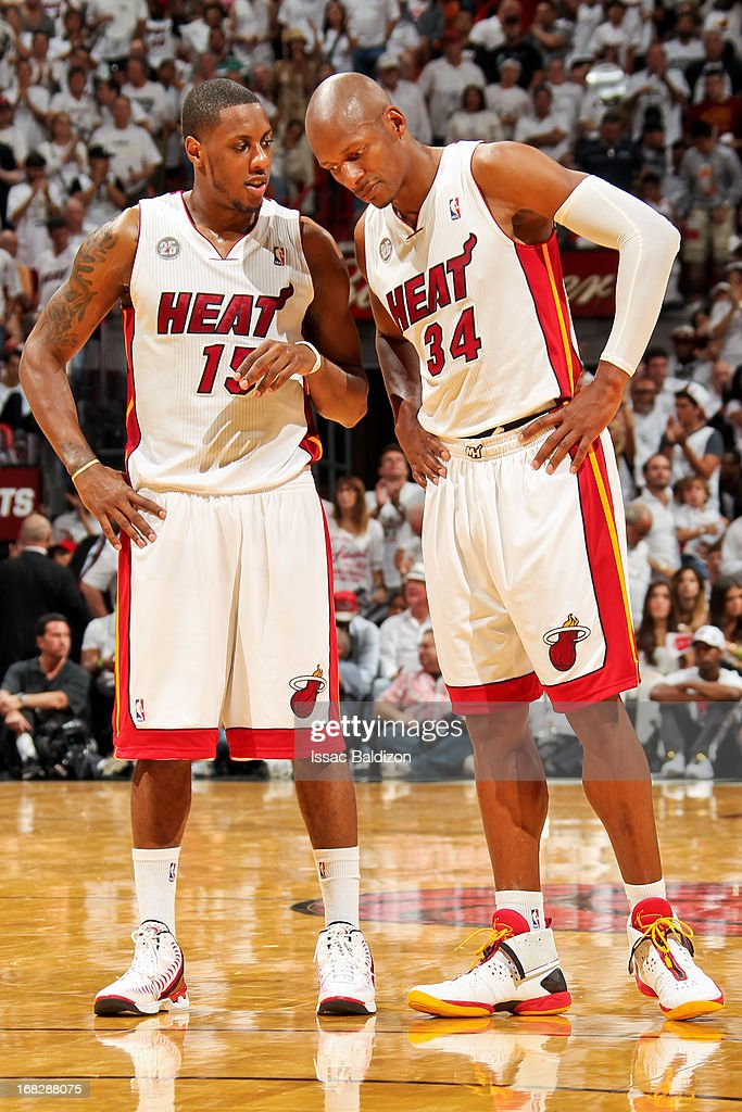 Mario Chalmers #15 and Ray Allen #34 of the Miami Heat speak while playing the Chicago Bulls in Game One of the Eastern Conference Semifinals during the 2013 NBA Playoffs on May 6, 2013 at American Airlines Arena in Miami, Florida.