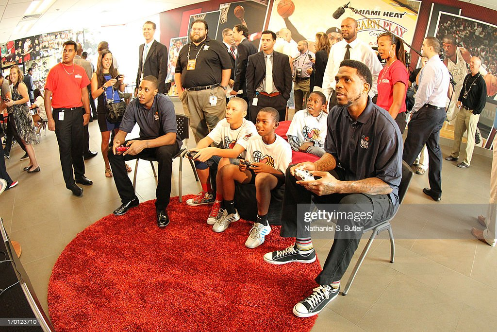 Mario Chalmers #15 and Udonis Haslem #40 of the Miami Heat plays some video games at the 2013 NBA Finals Legacy Project as part of the 2013 NBA Finals on June 7, 2013 at the Joe Celestin Center in Miami, Florida.
