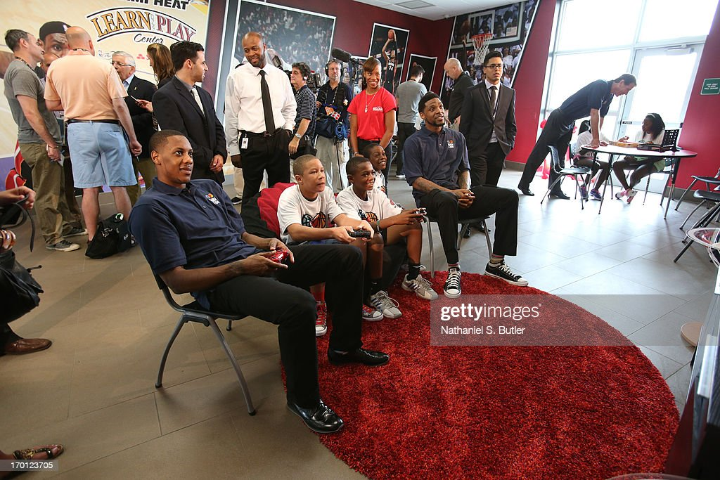 Mario Chalmers #15 and Udonis Haslem #40 of the Miami Heat plays video games with some kids at the 2013 NBA Finals Legacy Project as part of the 2013 NBA Finals on June 7, 2013 at the Joe Celestin Center in Miami, Florida.