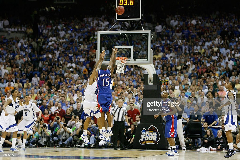 Mario Chalmers of the Kansas Jayhawks shoots and makes a threepointer to tie the game to send it into overtime against the Memphis Tigers during the...