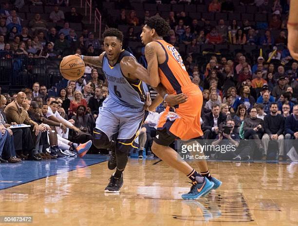 Mario Chalmers of the Memphis Grizzlies drives around d Cameron Payne of the Oklahoma City Thunder during a NBA game at the Chesapeake Energy Arena...