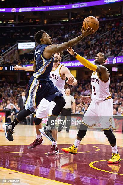 Mario Chalmers of the Memphis Grizzlies shoots over Kevin Love and Kyrie Irving of the Cleveland Cavaliers during the first half at Quicken Loans...