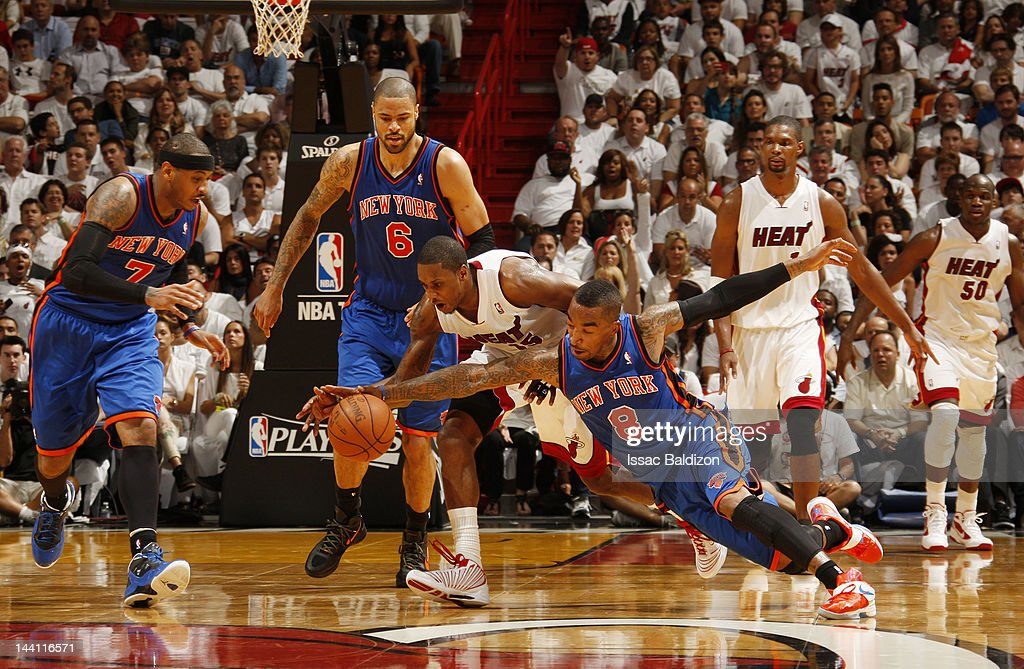 <a gi-track='captionPersonalityLinkClicked' href=/galleries/search?phrase=Mario+Chalmers&family=editorial&specificpeople=802115 ng-click='$event.stopPropagation()'>Mario Chalmers</a> #15 of the Miami Heat and <a gi-track='captionPersonalityLinkClicked' href=/galleries/search?phrase=J.R.+Smith&family=editorial&specificpeople=201766 ng-click='$event.stopPropagation()'>J.R. Smith</a> #8 of the New York Knicks reach for the ball in Game Five of the Eastern Conference Quarterfinals during the 2012 NBA Playoffs on May 9, 2012 at American Airlines Arena in Miami, Florida.