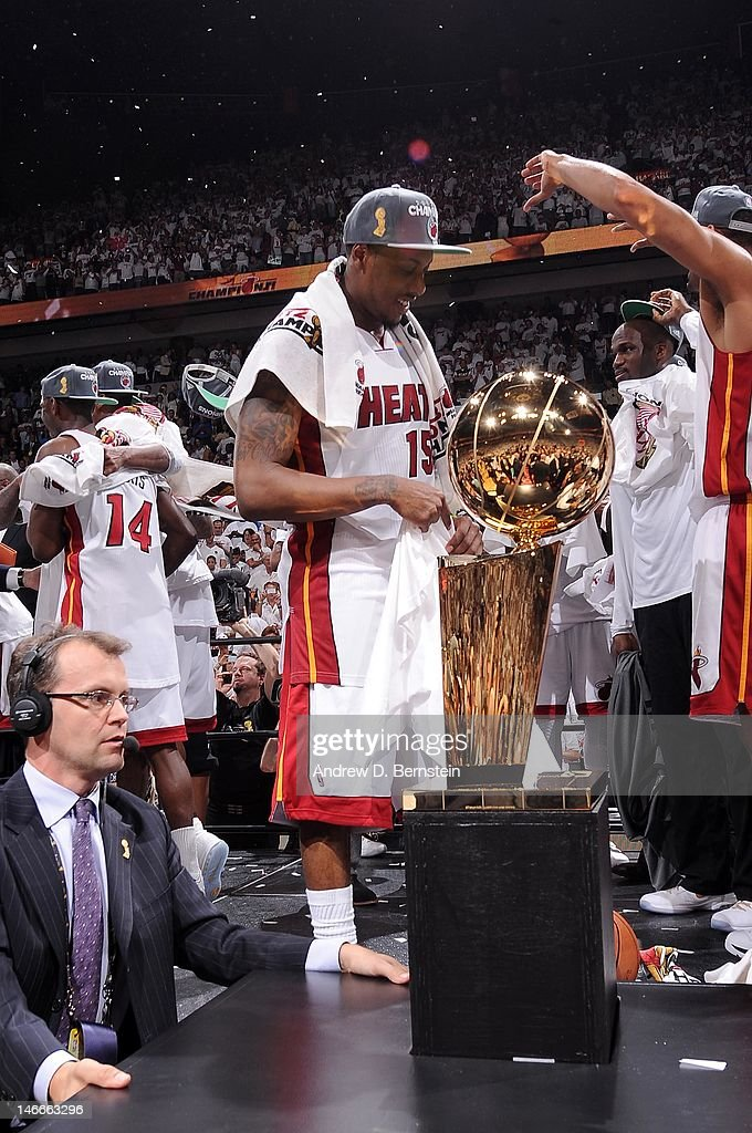 <a gi-track='captionPersonalityLinkClicked' href=/galleries/search?phrase=Mario+Chalmers&family=editorial&specificpeople=802115 ng-click='$event.stopPropagation()'>Mario Chalmers</a> #15 of the Miami Heat and teammates gather around the Larry O'Brien Championship trophy after the team's 121-106 victory against the Oklahoma City Thunder in Game Five of the 2012 NBA Finals between the Miami Heat and the Oklahoma City Thunder at American Airlines Arena on June 21, 2012 in Miami, Florida.