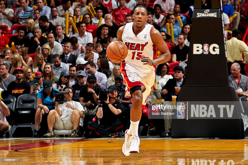 Mario Chalmers #15 of the Miami Heat brings the ball up court against the Chicago Bulls on January 4, 2013 at American Airlines Arena in Miami, Florida.