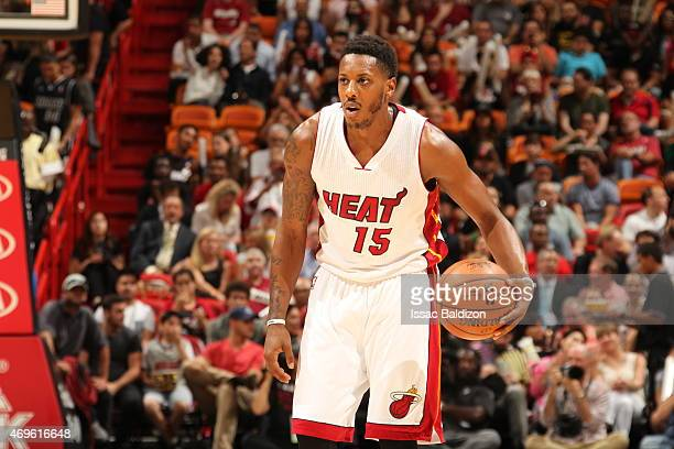 Mario Chalmers of the Miami Heat brings the ball up court against the Orlando Magic on April 13 2015 at American Airlines Arena in Miami Florida NOTE...