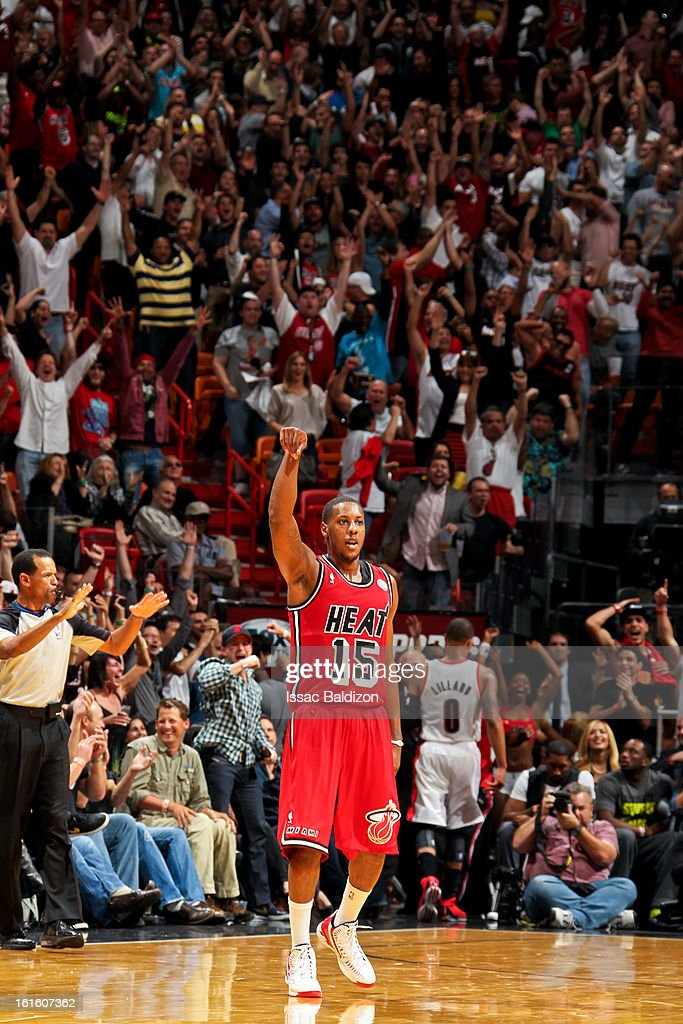 Mario Chalmers #15 of the Miami Heat celebrates after making a three-pointer against the Portland Trail Blazers on February 12, 2013 at American Airlines Arena in Miami, Florida.