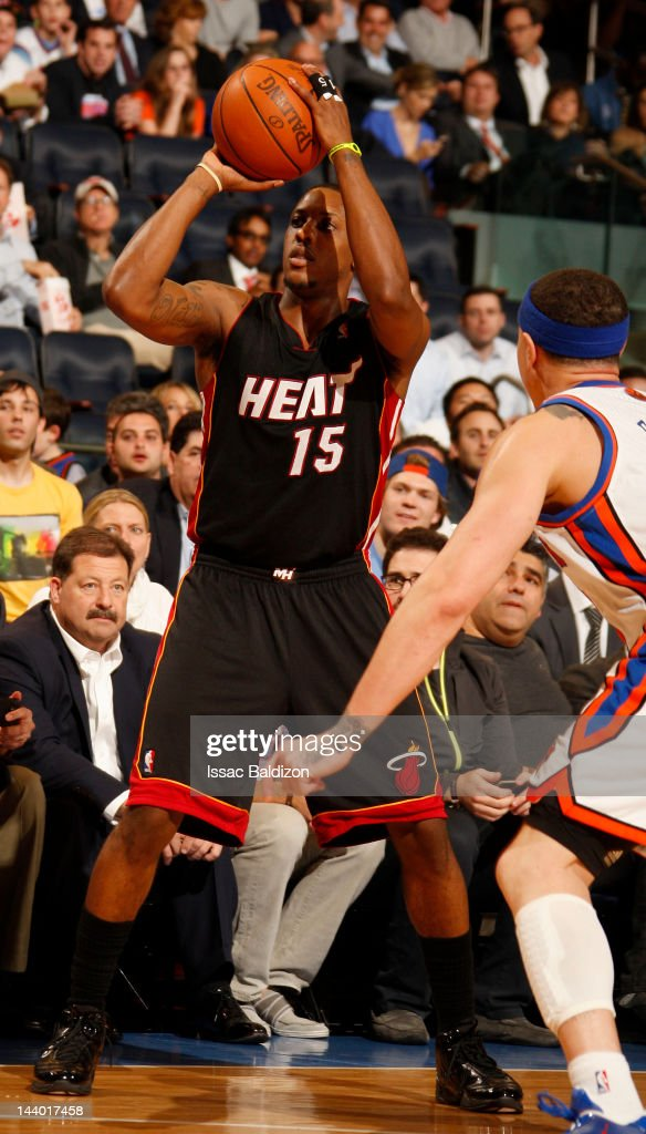 Mario Chalmers #15 of the Miami Heat controls the ball against Mike Bibby #20 of the New York Knicks in Game Three of the Eastern Conference Quarterfinals during the 2012 NBA Playoffs on May 3, 2012 at Madison Square Garden in New York City, New York.