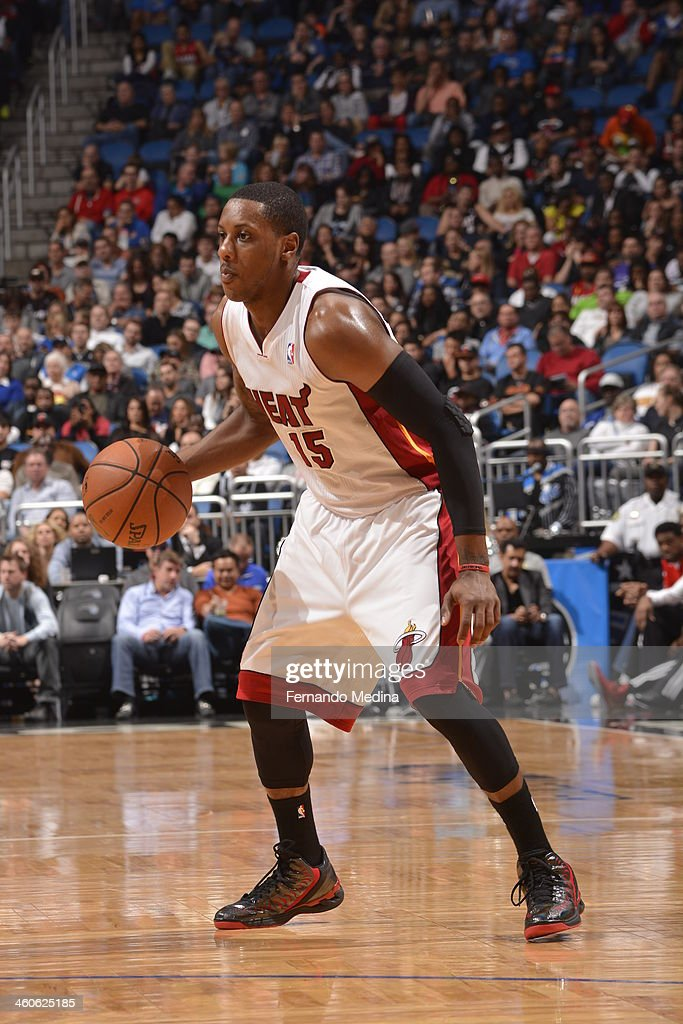 Mario Chalmers of the Miami Heat controls the ball against the Orlando Magic on January 4 2014 at Amway Center in Orlando Florida NOTE TO USER User...