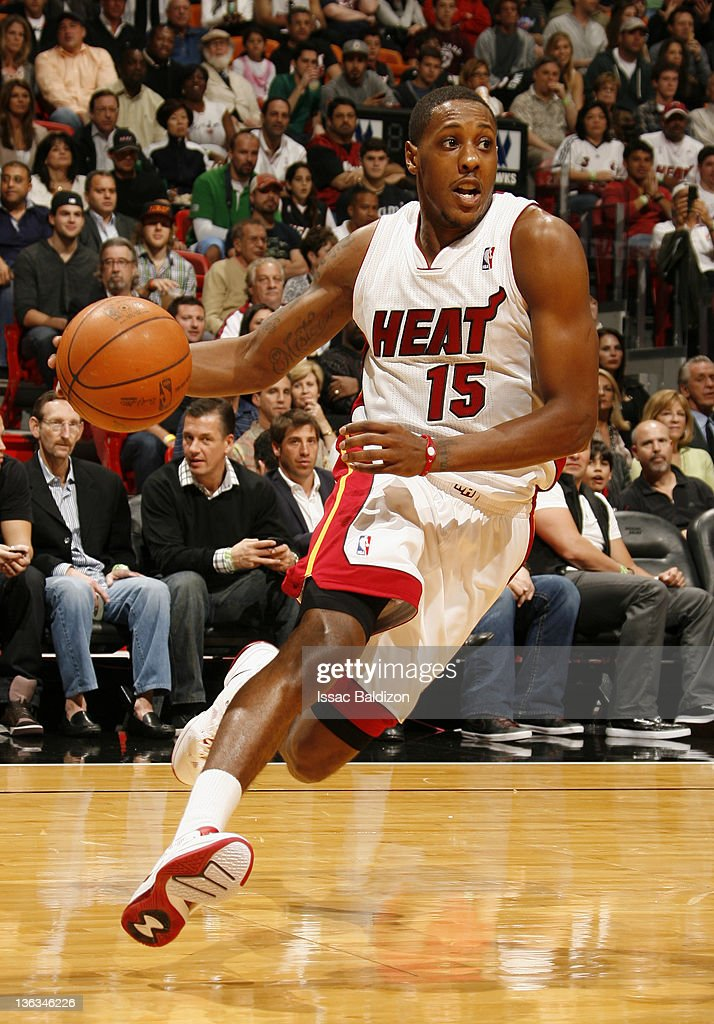 Mario Chalmers #15 of the Miami Heat controls the ball during the first quarter against the Atlanta Hawks on January 2, 2012 at American Airlines Arena in Miami, Florida.