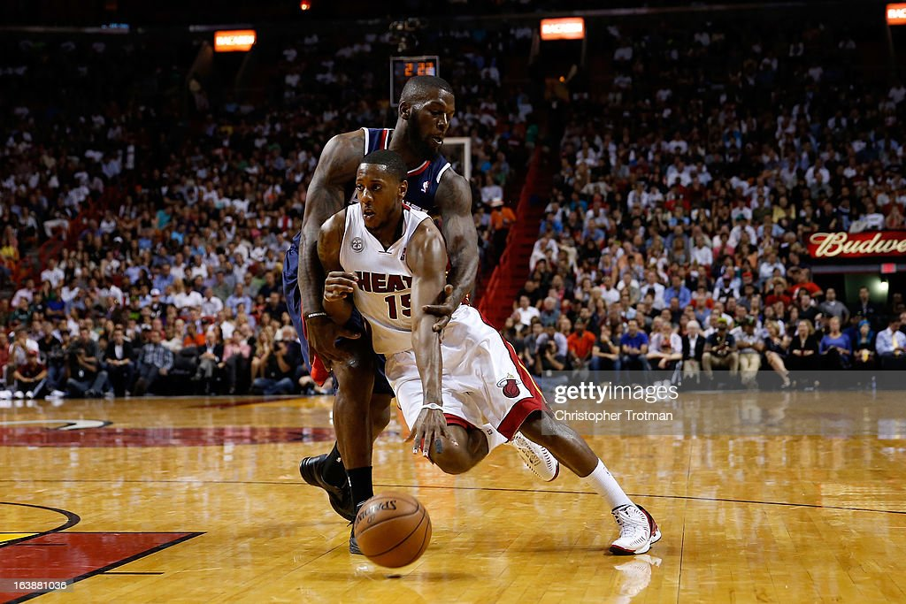 Mario Chalmers #15 of the Miami Heat drives against Ivan Johnson #44 of the Atlanta Hawks at American Airlines Arena on March 12, 2013 in Miami, Florida.