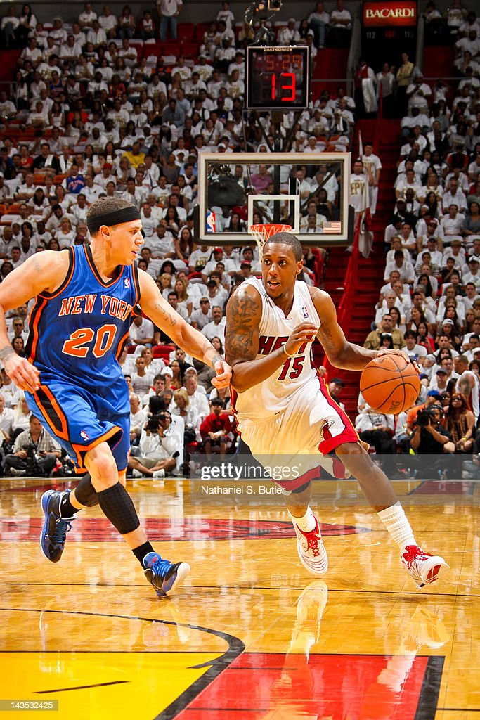 Mario Chalmers #15 of the Miami Heat drives against Mike Bibby #20 of the New York Knicks in Game One of the Eastern Conference Quarterfinals during the 2012 NBA Playoffs on April 28, 2012 at American Airlines Arena in Miami, Florida.