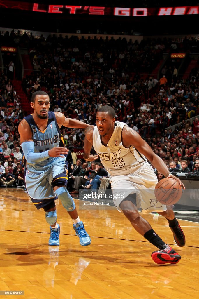 Mario Chalmers #15 of the Miami Heat drives against Mike Conley #11 of the Memphis Grizzlies on March 1, 2013 at American Airlines Arena in Miami, Florida.
