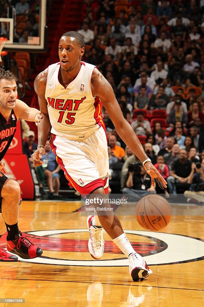 Mario Chalmers #15 of the Miami Heat drives against the Toronto Raptors on January 23, 2013 at American Airlines Arena in Miami, Florida.
