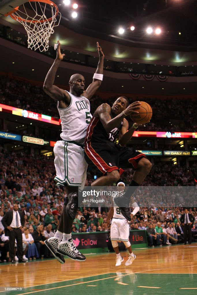 Mario Chalmers #15 of the Miami Heat drives for a shot attempt in the seocnd half against Kevin Garnett #5 of the Boston Celtics in Game Three of the Eastern Conference Finals in the 2012 NBA Playoffs on June 1, 2012 at TD Garden in Boston, Massachusetts.
