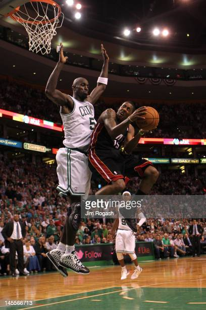 Mario Chalmers of the Miami Heat drives for a shot attempt in the seocnd half against Kevin Garnett of the Boston Celtics in Game Three of the...