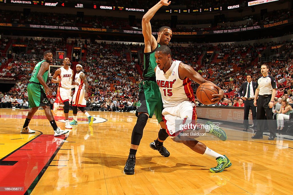 Mario Chalmers #15 of the Miami Heat drives to the basket against Courtney Lee #11 of the Boston Celtics on April 12, 2013 at American Airlines Arena in Miami, Florida.
