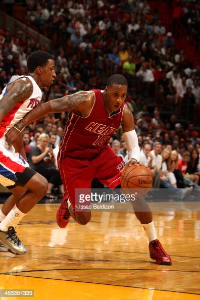 Mario Chalmers of the Miami Heat drives to the basket against Kentavious CaldwellPope of the Detroit Pistons on December 3 2013 at American Airlines...