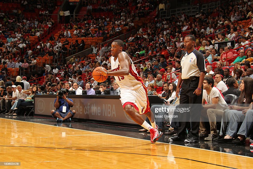<a gi-track='captionPersonalityLinkClicked' href=/galleries/search?phrase=Mario+Chalmers&family=editorial&specificpeople=802115 ng-click='$event.stopPropagation()'>Mario Chalmers</a> #15 of the Miami Heat drives to the basket against the Atlanta Hawks during a game on October 7, 2013 at American Airlines Arena in Miami, Florida.