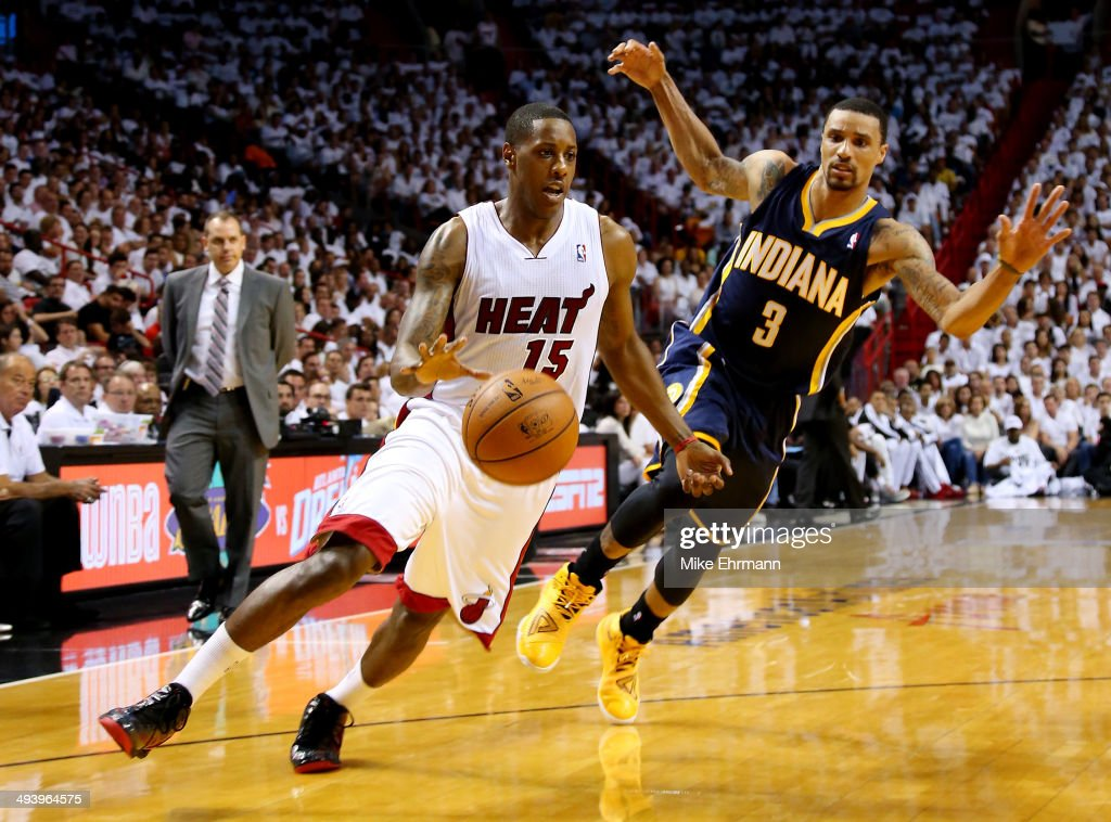 Mario Chalmers #15 of the Miami Heat drives to the basket as George Hill #3 of the Indiana Pacers defends during Game Four of the Eastern Conference Finals of the 2014 NBA Playoffs at American Airlines Arena on May 26, 2014 in Miami, Florida.