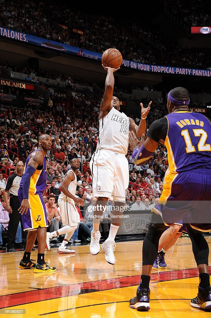Mario Chalmers #15 of the Miami Heat goes for a jump shot during a game between the Los Angeles Lakers and the Miami Heat on February 10, 2013 at American Airlines Arena in Miami, Florida.