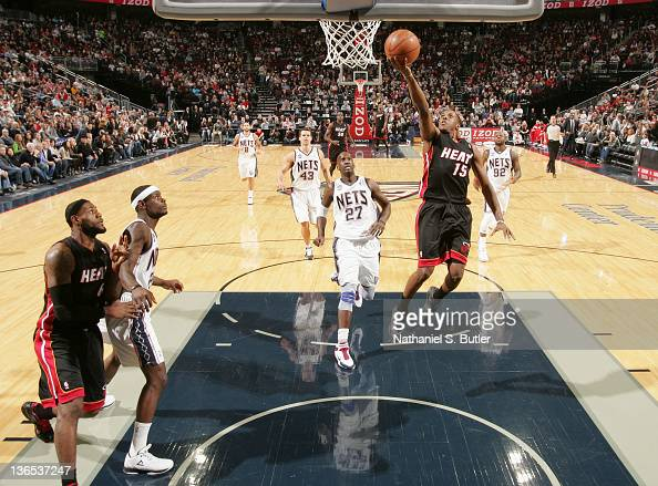 Mario Chalmers of the Miami Heat goes to the basket during the first half against the New Jersey Nets on January 7 2012 at the Prudential Center in...