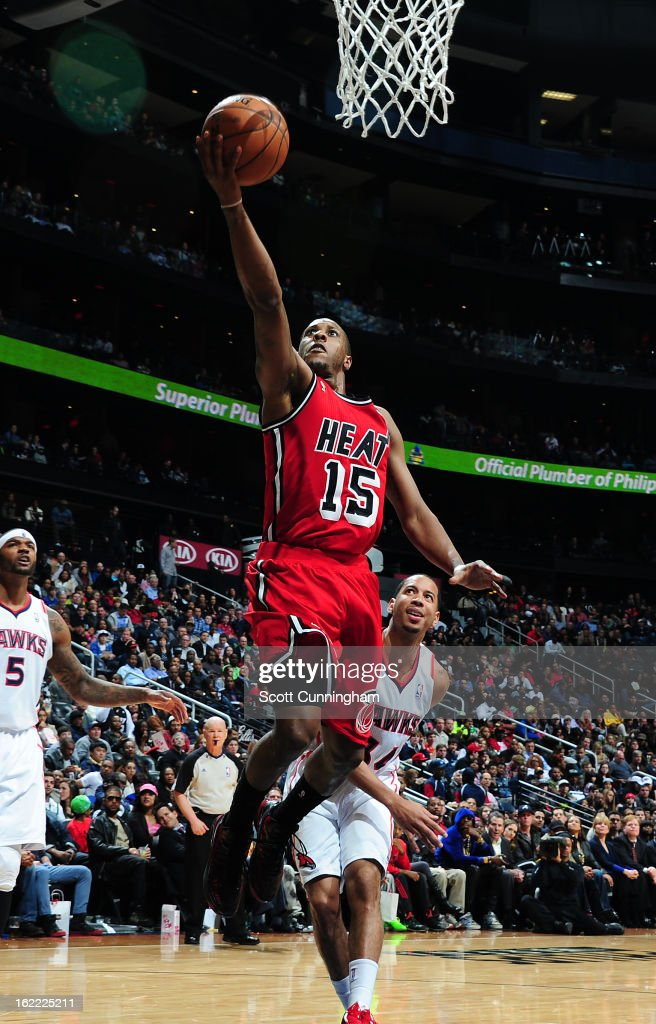 Mario Chalmers #15 of the Miami Heat goes up for the layup against the Atlanta Hawks on February 20, 2013 at Philips Arena in Atlanta, Georgia.
