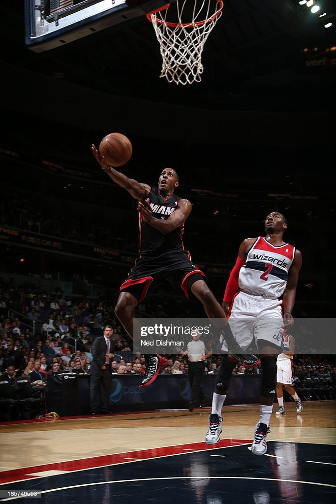 <a gi-track='captionPersonalityLinkClicked' href=/galleries/search?phrase=Mario+Chalmers&family=editorial&specificpeople=802115 ng-click='$event.stopPropagation()'>Mario Chalmers</a> #15 of the Miami Heat goes up for the layup against the Washington Wizards during the pre-season game at the Verizon Center on October 15, 2013 in Washington, DC.
