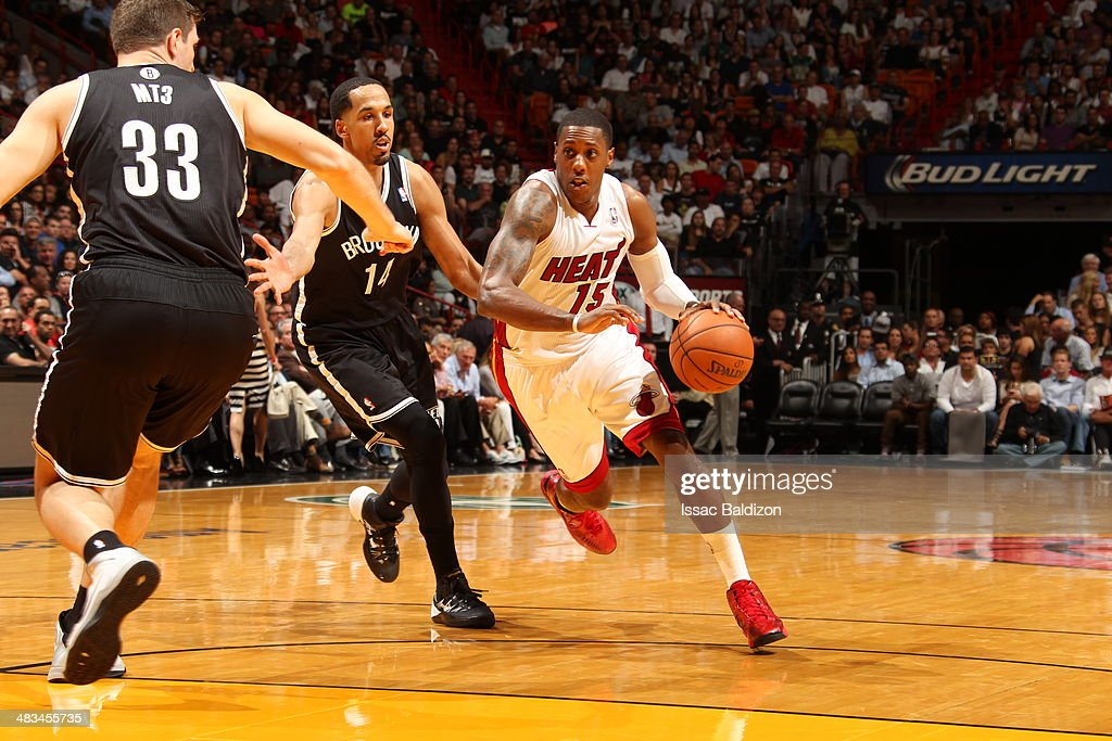 Mario Chalmers #15 of the Miami Heat goes up for the layup against the Brooklyn Nets during game on April 8, 2014 at American Airlines Arena in Miami, Florida.
