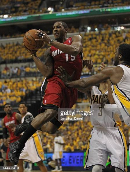 Mario Chalmers of the Miami Heat leaps to pass as George Hill and Ray Hibbert of the Indiana Pacers defend in Game Three of the Eastern Conference...
