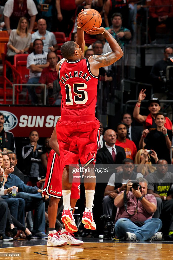 Mario Chalmers #15 of the Miami Heat makes a three-pointer against the Portland Trail Blazers on February 12, 2013 at American Airlines Arena in Miami, Florida.