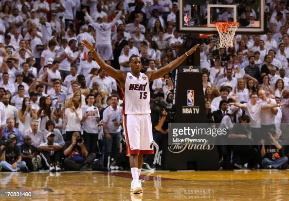 Mario Chalmers of the Miami Heat reacts in overtime against the San Antonio Spurs during Game Six of the 2013 NBA Finals at AmericanAirlines Arena on...