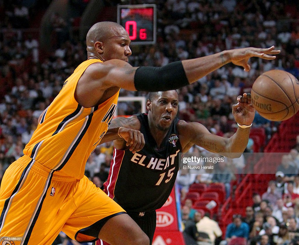 Mario Chalmers of the Miami Heat, right, battles for a loose ball against David West of the Indiana Pacers during the second quarter at the AmericanAirlines Arena in Miami, Florida, Sunday, March 10, 2013. Miami defeated Indiana, 105-91.