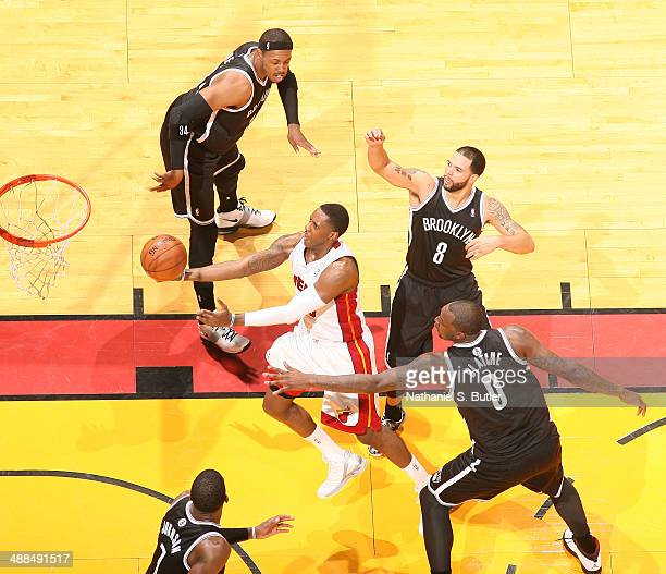Mario Chalmers of the Miami Heat shoots against Andray Blatche of the Brooklyn Nets during Game One of the Eastern Conference Semifinals of the 2014...