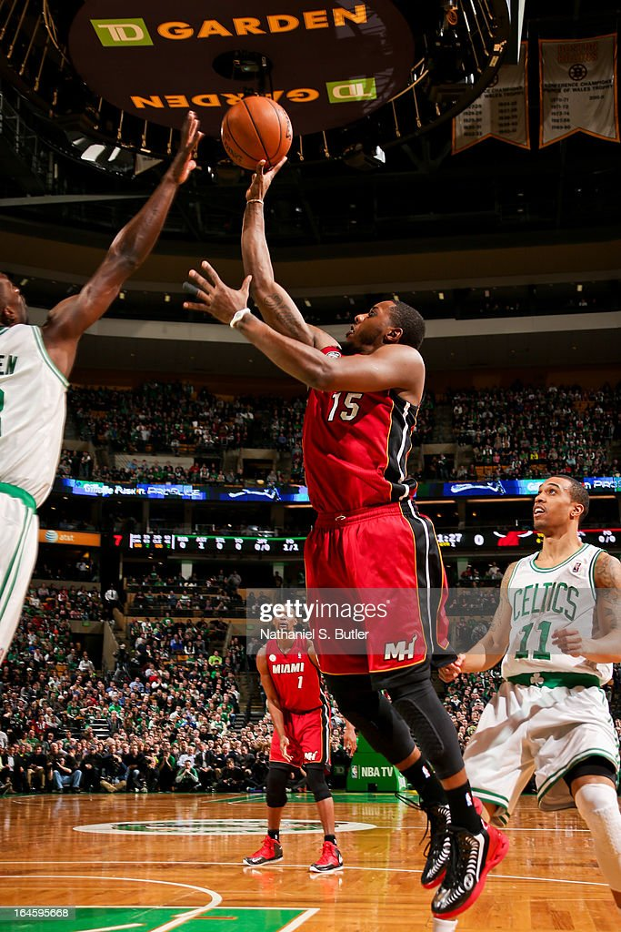 Mario Chalmers #15 of the Miami Heat shoots against Jeff Green #8 of the Boston Celtics on March 18, 2013 at TD Garden in Boston, Massachusetts.