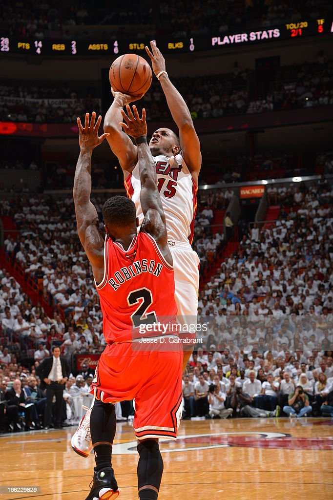 Mario Chalmers #15 of the Miami Heat shoots against Nate Robinson #2 of the Chicago Bulls in Game One of the Eastern Conference Semifinals during the 2013 NBA Playoffs on May 6, 2013 at American Airlines Arena in Miami, Florida.