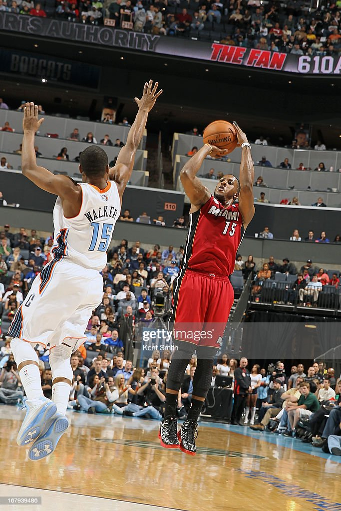 Mario Chalmers #15 of the Miami Heat shoots the ball against the Charlotte Bobcats at the Time Warner Cable Arena on April 5, 2013 in Charlotte, North Carolina.