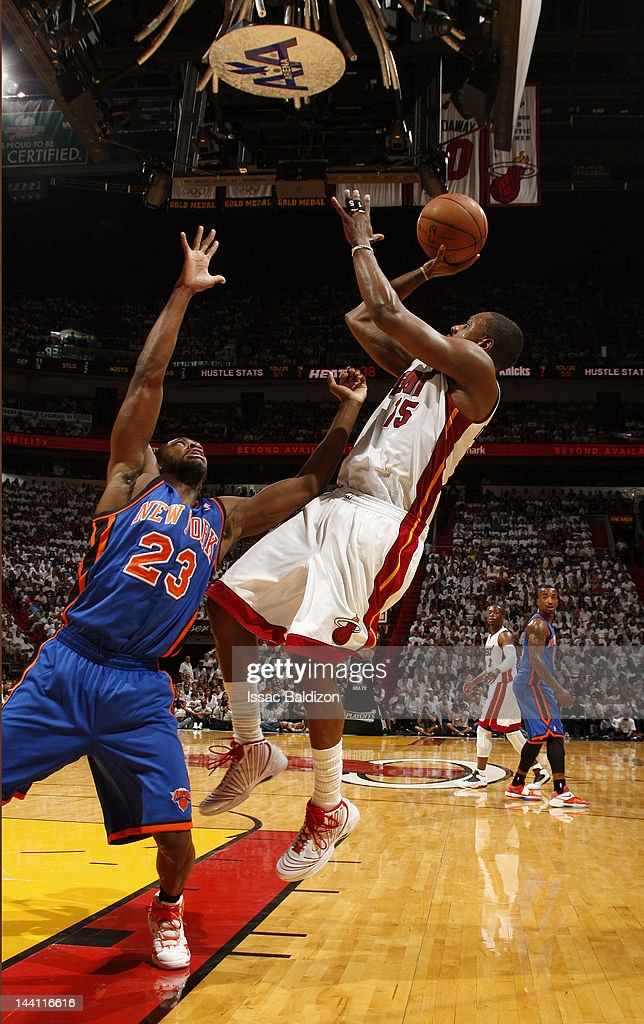 <a gi-track='captionPersonalityLinkClicked' href=/galleries/search?phrase=Mario+Chalmers&family=editorial&specificpeople=802115 ng-click='$event.stopPropagation()'>Mario Chalmers</a> #15 of the Miami Heat takes a jump shot against <a gi-track='captionPersonalityLinkClicked' href=/galleries/search?phrase=Toney+Douglas&family=editorial&specificpeople=2536966 ng-click='$event.stopPropagation()'>Toney Douglas</a> #23 of the New York Knicks in Game Five of the Eastern Conference Quarterfinals during the 2012 NBA Playoffs on May 9, 2012 at American Airlines Arena in Miami, Florida.