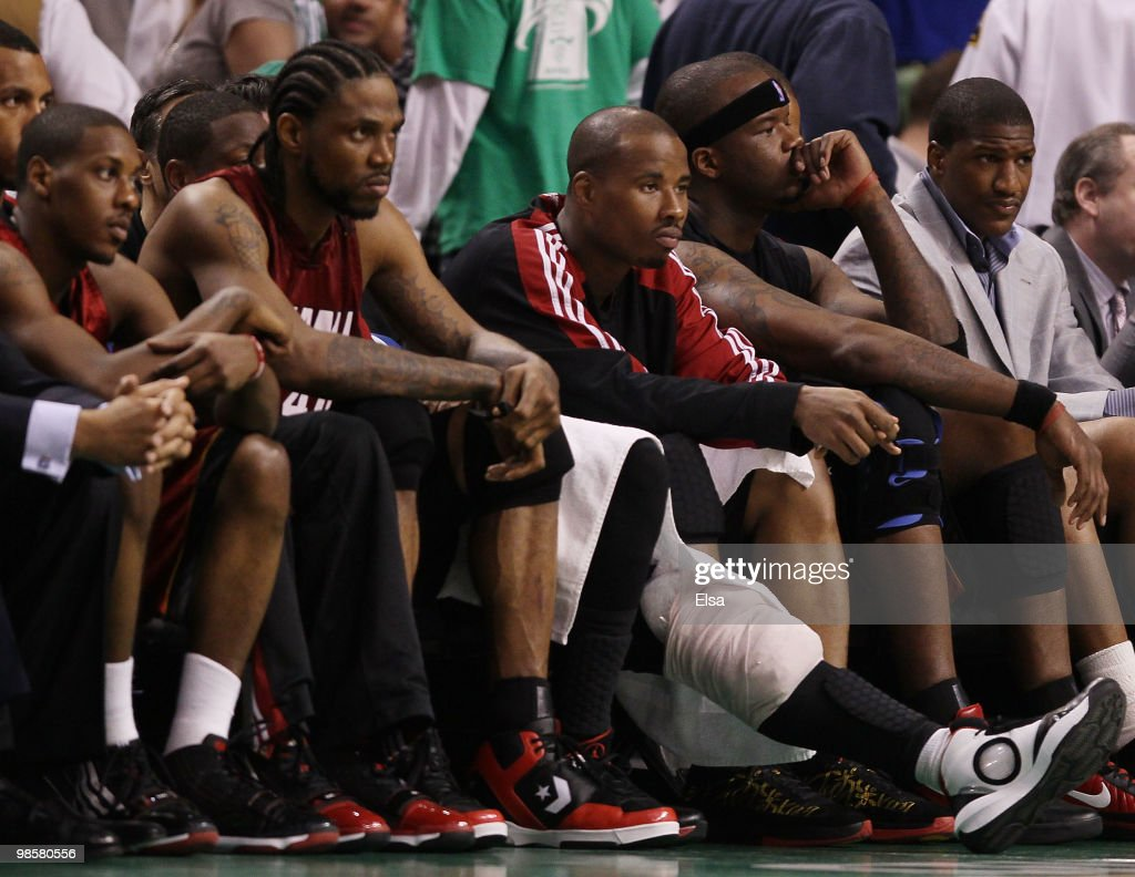 Mario Chalmers Udonis HaslemQuentin Richardson and Jermaine O'Neal of the Miami Heat sit on the bench in the fourth quarter against the Boston...